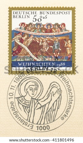 ST. PETERSBURG, RUSSIA - APR 25, 2016: A postmark Germany, shows Illumination from The Gospel Book of Henry Lion, Helmarshausen, 1188: Angels announce the birth of Christ to the shepherds, circa 1988 - stock photo