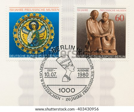 ST. PETERSBURG, RUSSIA - APR 8, 2016: A postmark Germany, shows Prussian Museum Berlin. Angel, enamel medallion, Monks Reading oak sculpture by Ernest Barlach (1870-1938) and Nefertiti, circa 1980 - stock photo