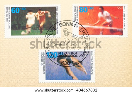 ST. PETERSBURG, RUSSIA - APR 12, 2016: A postmark printed in Germany, shows Soccer, Tennis, Diving. Surtax for Stiftung Deutsche Sporthilfe, foundation for the promotion sports in Germany, circa 1988 - stock photo