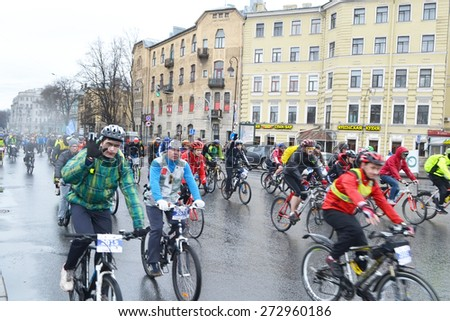 """ST.PETERSBURG, RUSSIA - APRIL 26, 2015: Bike Ride """"Opening the cycling season 2015"""". Cycle race on street of St.Petersburg. - stock photo"""