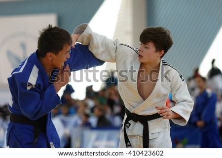 ST. PETERSBURG, RUSSIA - APRIL 16, 2016: Fight Baiaman Sagynbai Uulu of Kyrgyzstan (blue) vs Neil MacDonald of Great Britain during Junior European Judo Cup. 346 athletes participated in competition