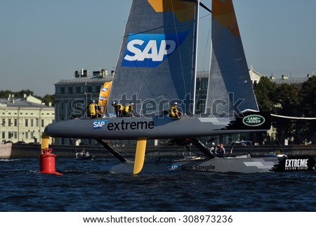 ST. PETERSBURG, RUSSIA - AUGUST 21, 2015: Catamaran of SAP Extreme Sailing Team of Denmark during the 2nd day of St. Petersburg stage of Extreme Sailing Series. Red Bull Team leading after the 1st day - stock photo