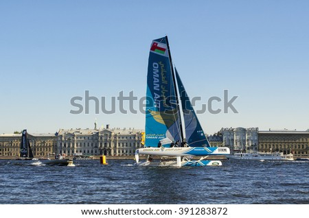 ST.PETERSBURG, RUSSIA - AUGUST 21, 2015: Oman Air team on the 6th act of Extreme Sailing Series race