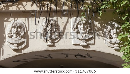 ST. PETERSBURG, RUSSIA -  AUGUST 31, 2015: Photo of  Bas-relief the Beatles. - stock photo