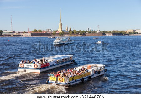 ST.PETERSBURG, RUSSIA - AUGUST 5, 2015: River cruise boats on the Neva  river in summer sunny day - stock photo