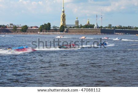 ST.PETERSBURG, RUSSIA - AUGUST 09: Speed boats on water on line on Neva at Formula 1 Powerboat World Championship race on August 09, 2009 in St.Petersburg, Russia. - stock photo