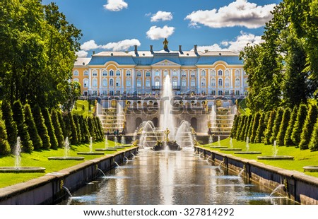 ST. PETERSBURG, RUSSIA - AUGUST 15, 2015: The Peterhof Grand Palace on August 15, 2015. The Palace is included in the UNESCO Heritage List. - stock photo