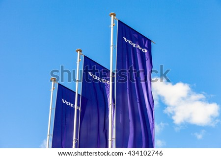 ST.PETERSBURG, RUSSIA - AUGUST 5, 2015: Volvo dealership flags over blue sky. Volvo is a Swedish multinational automaker company  - stock photo