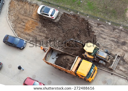 ST. PETERSBURG, RUSSIA - CIRCA APR, 2015: Wrong parking car is on lawn while construction machinery works for extension of parking area of apartment building. Creation of living environment in city - stock photo