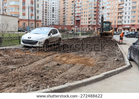 ST. PETERSBURG, RUSSIA - CIRCA APR, 2015: Wrong parking vehicle stands on lawn while construction machinery works for extension of parking area of apartment building. Creation of living environment - stock photo