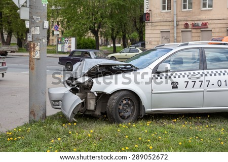 ST. PETERSBURG, RUSSIA - CIRCA MAY, 2015: Crashed car is on pavement after frontal collision with pole. Accident with passing crossroads at a red light. No one injured. - stock photo