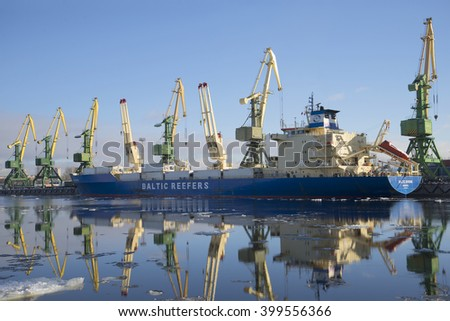 "ST. PETERSBURG, RUSSIA - FEBRUARY 17, 2016: Vessel for transportation of containers-refrigerators ""Baltic spring"" on unloading at the St. Petersburg cargo port"