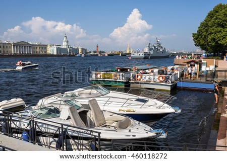 ST PETERSBURG, RUSSIA - July 27, 2016: Boats and military ship on Neva river during summer Navy Days