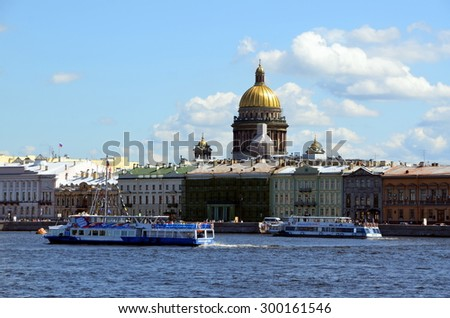 ST-PETERSBURG, RUSSIA - JULY 25, 2015 - Tourist boats on a background of the English Quay in Saint Petersburg. It has been historically one of the most fashionable streets in Saint Petersburg