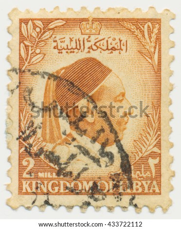 ST. PETERSBURG, RUSSIA - JUNE 8, 2016: A postmark printed in Kingdom of Libya, shows portrait of King Idris as-Senussi (1890-1983), circa 1952