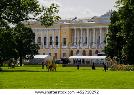 St.Petersburg, Russia - June 15, 2016: Large lawn of the Mikhailovsky Garden and the Mikhailovsky Palace.