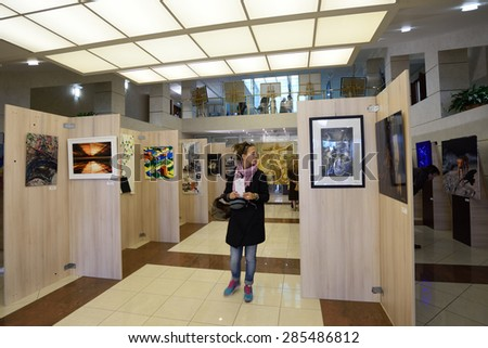 "ST. PETERSBURG, RUSSIA - JUNE 7, 2015: People at first exhibition of the project ""Modern artists of the world"". Over 300 paintings and sculptures exposed in the Center of modern art of Congress Palace"