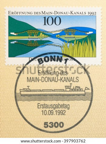ST. PETERSBURG, RUSSIA - MAR 28, 2016: A first day of issue postmark printed in Bonn, Germany, shows  Main-Danube Canal and ship on the stamp, circa 1992 - stock photo