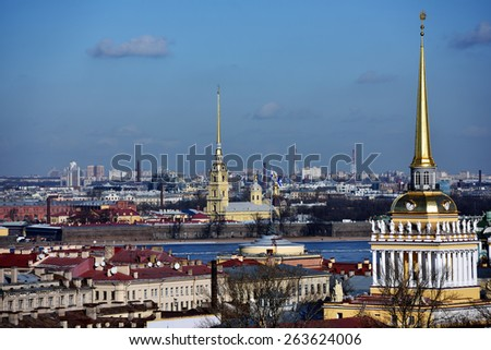 ST. PETERSBURG, RUSSIA - MARCH 5, 2015: Cityscape viewed from the St. Isaac's Cathedral with the spire of Admiralty and the spire of the Peter and Paul Cathedral. It is two most famous spires of city - stock photo