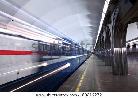St. Petersburg, Russia - March 7, 2014: Underground train departs from the Metro Akademicheskaya. Russian subway underground station vestibule. Most Beautiful Subway Stations - stock photo