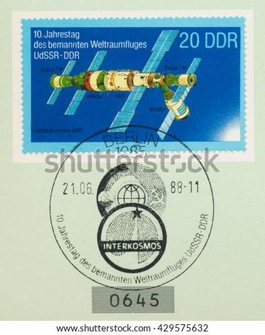 ST. PETERSBURG, RUSSIA - MAY 31, 2016: A postmark printed in DDR, shows MIR space station, series USSR-DDR Manned Space Flight, 10th Anniv., circa 1988