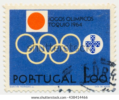 ST. PETERSBURG, RUSSIA - MAY 17, 2016: A postmark printed in PORTUGAL, shows Olympic Rings, Emblems of Portugal and Japan, circa 1964 - stock photo