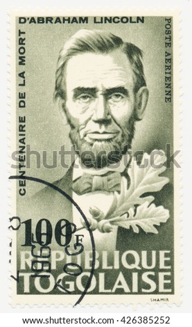 ST. PETERSBURG, RUSSIA - MAY 25, 2016: A postmark printed in TOGO, shows portrait of Abraham Lincoln (1809-1865) 16th President of the United States, circa 1965 - stock photo
