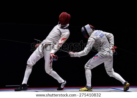 ST. PETERSBURG, RUSSIA - MAY 3, 2015: Final match Russia vs China during 41th International fencing tournament St. Petersburg Foil. The tournament is the stage of FIE World Cup - stock photo