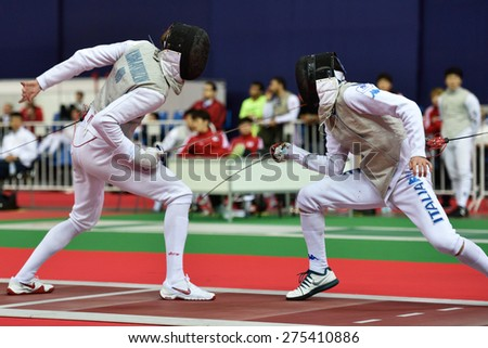 ST. PETERSBURG, RUSSIA - MAY 3, 2015: Team semifinal match Russia vs Italy during 41th International fencing tournament St. Petersburg Foil. The tournament is the stage of FIE World Cup - stock photo