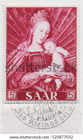 ST. PETERSBURG, RUSSIA - NOV 8, 2016: A postmark printed in SAAR, shows Madonna and Child by Hans Holbein (1497-1543), circa 1954