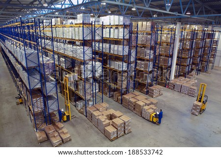 St. Petersburg, Russia - November 21, 2008: Interior warehouse storage, vertical storage, pallets on shelves overhead racks, interior large warehouse with freight stacked high.  - stock photo
