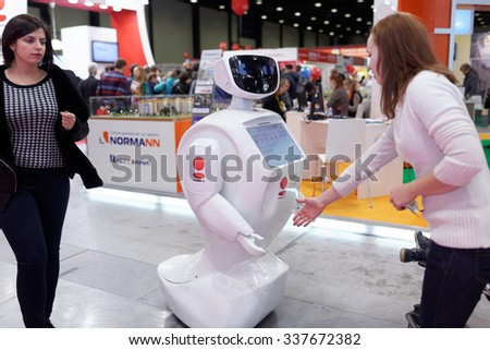 ST. PETERSBURG, RUSSIA - OCTOBER 31, 2015: Robot promoter of the bank Saint-Petersburg in the Expoforum during the Real Estate Fair. It is the largest real estate exhibition in Russia - stock photo
