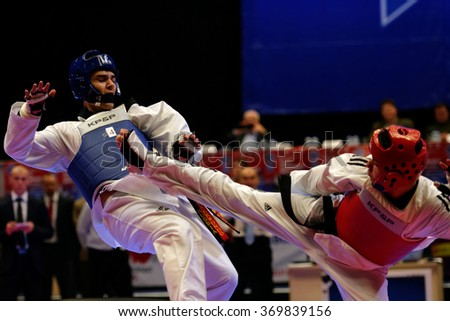 ST. PETERSBURG, RUSSIA - OCTOBER 17, 2015: Taekwondo WTF junior teams match Russia vs Iran during the martial arts festival Baltic Sea Cup in Sibur Arena - stock photo