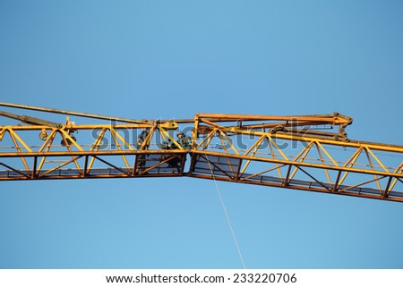 St. Petersburg, Russia - October 30, 2014: Workers installers are working at high altitude, fixing sections of the working jib construction tower crane.