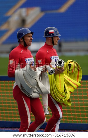 ST. PETERSBURG, RUSSIA - SEPTEMBER 9, 2015: Athletes of Team Poland with fire hose after competitions in combat deployment during XI World Championship in Fire and Rescue Sport - stock photo