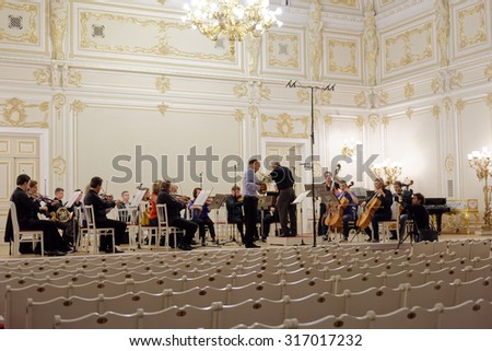 ST. PETERSBURG, RUSSIA - SEPTEMBER 7, 2015: Conductor Hermann Baumann and soloist Javier Bonet on the rehearsal with symphonic orchestra Nevsky during the International festival of French horn - stock photo