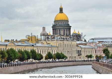 ST.PETERSBURG, RUSSIA, SEPTEMBER, 02, 2014. Russian scene: View of St. Isaac's Cathedral from the Moyka river in cloudy weather,