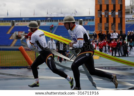 ST. PETERSBURG, RUSSIA - SEPTEMBER 9, 2015: Team Germany during competitions in combat deployment during the XI World Championship in Fire and Rescue Sport. First World Championship was held in 2002 - stock photo