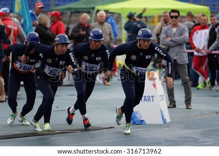 ST. PETERSBURG, RUSSIA - SEPTEMBER 9, 2015: Team Korea during competitions in combat deployment during the XI World Championship in Fire and Rescue Sport. First World Championship was held in 2002 - stock photo