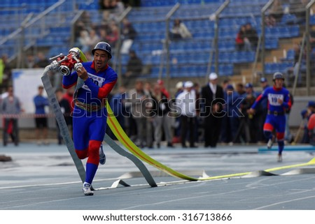 ST. PETERSBURG, RUSSIA - SEPTEMBER 9, 2015: Team Mongolia during competitions in combat deployment during the XI World Championship in Fire and Rescue Sport. First World Championship was held in 2002 - stock photo