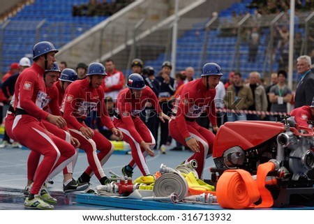 ST. PETERSBURG, RUSSIA - SEPTEMBER 9, 2015: Team Poland during competitions in combat deployment during the XI World Championship in Fire and Rescue Sport. First World Championship was held in 2002 - stock photo