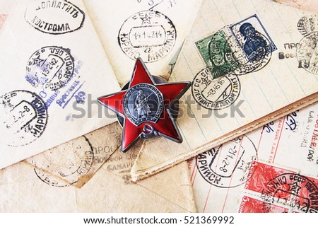 "ST.PETERSBURG, USSR - November 13, 2016: Military medal "" Red Star"" on the letters with the stamp ""Censorship looked"" from World War Two , USSR"