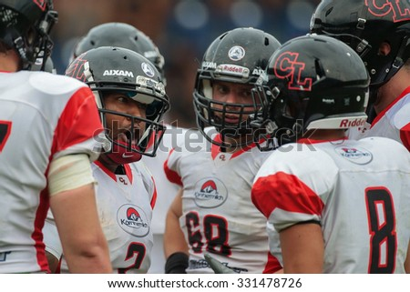 ST. POELTEN, AUSTRIA - JULY 26, 2014: QB Phillip Garcia (#2 Lions) talks to his team in the huddle during Silver Bowl XVII. - stock photo