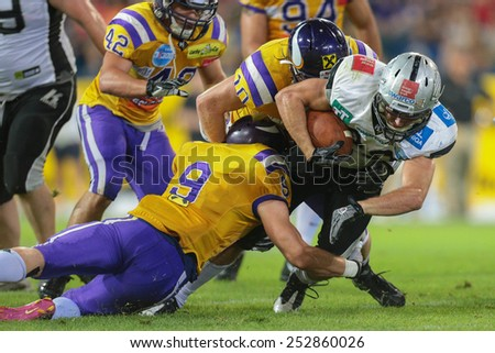ST. POELTEN, AUSTRIA - JULY 27 RB Andreas Hofbauer (#29 Raiders) is tackled at Austrian Bowl XXVII on July 27, 2013 in St. Poelten, Austria. - stock photo
