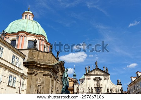 St. Savior (St. Salvador) church at Karlova street in the Old town, part of the Clementinum, one of the most precious early Baroque monuments in Prague. Saint Francis of Assisi Church to the left. - stock photo