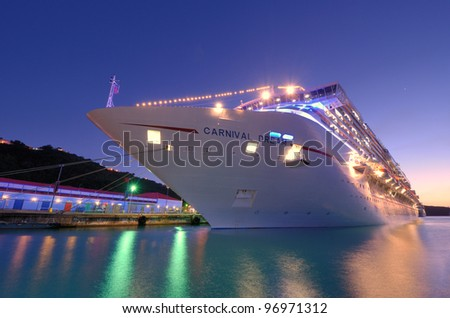ST. THOMAS - JANUARY 3: The Carnival Dream at Port January 3, 2012 in St. Thomas, U.S. Virgin Islands. The Dream is the biggest ship built for Carnival at 130,000 tons. - stock photo