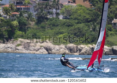 ST. THOMAS, USVI - MARCH 26: Beach Cat races in 2010 International Rolex Regatta in St. Thomas, USVI on March 26, 2010. - stock photo