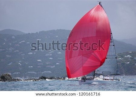 ST. THOMAS, USVI - MARCH 26:  Melges 24 with spinnaker up races in 2010 International Rolex Regatta in St. Thomas, USVI on March 26, 2010. - stock photo