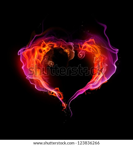 St. Valentine burning heart with flames against dark background - stock photo