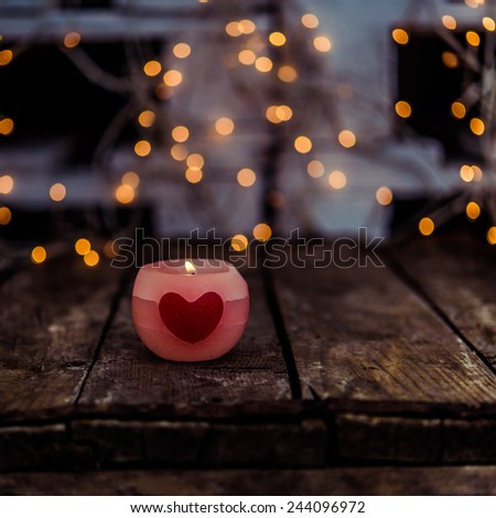 St Valentine's day greeting card with candle and hearts - stock photo